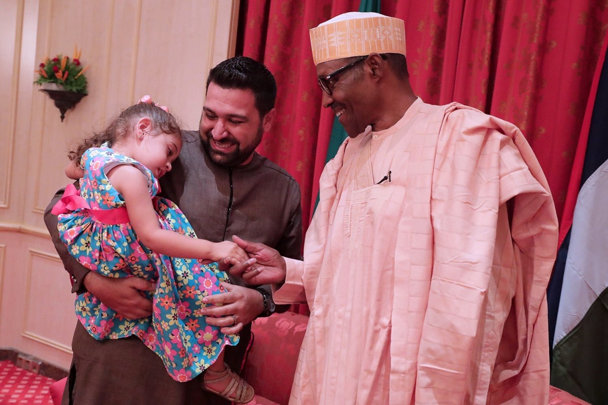President Buhari Jokes With Maya Jamal, Shy Three Year Old Nigerian Fan